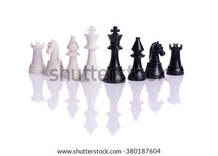 Chess game or chess pieces with white background - stock photo