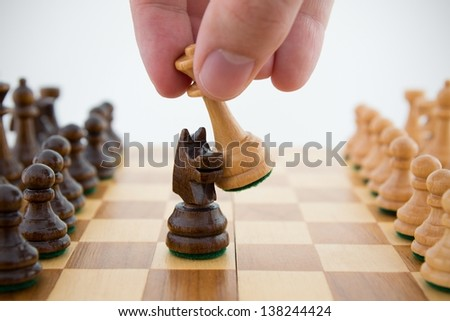 Chess game. Queen captures horse - stock photo
