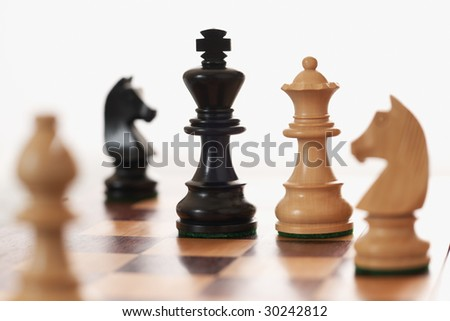 Chess game white queen challenging black king differential Focus - stock photo
