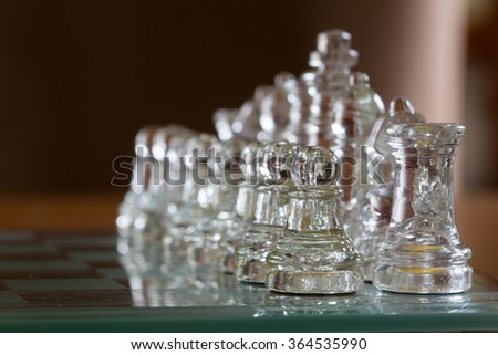Chess glass start up game for your business competition on chess board.