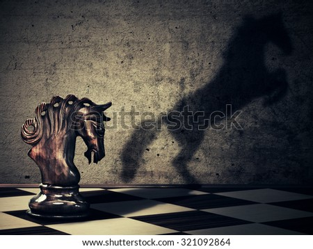 Chess horse with it wild horse shadow on two legs - stock photo