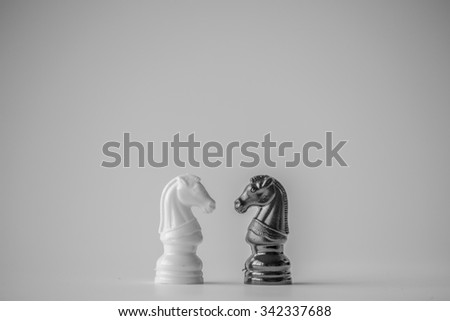 Chess is an strategy and intelligence board game originated in India that is played between two people on a chessboard - stock photo