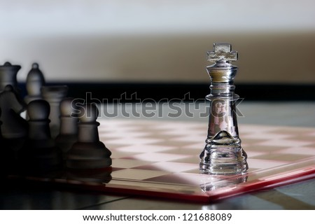Chess King as a business concept - strategy, advertising, marketing, sales, competition, leadership, CEO, business skills - King in light, other pieces in shadow - advertising!