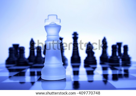 Chess king on chess board - stock photo