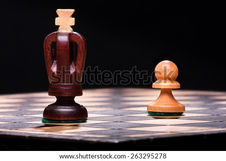 chess king with pawn - stock photo