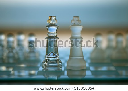 Chess Kings - business concept series - merger / merge, competition, strategy, opponent.  - stock photo