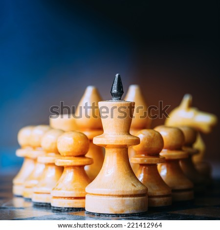 Chess Leader Leading His Army White Wooden Figures. Concept Game. Close Up Focus