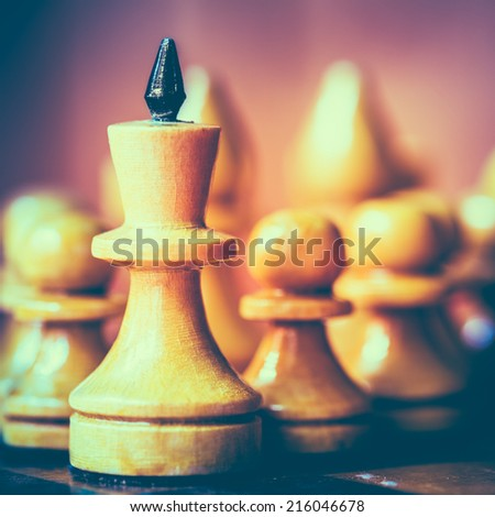 Chess Leader Led King His Army White Wooden Figures. Concept Game. Close Up Focus. Toned Instant Photo - stock photo