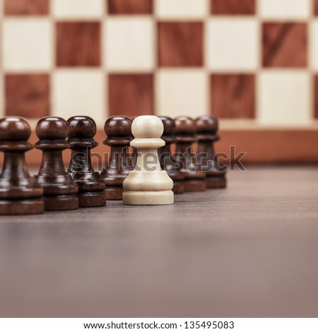 chess leadership concept on the chessboard background