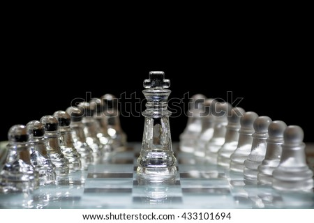 Chess on a black background./ Create focus blur that background component image./ Glass chess on a black background. - stock photo