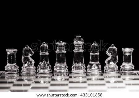 Chess on a black background./ Glass chess on a black background. - stock photo