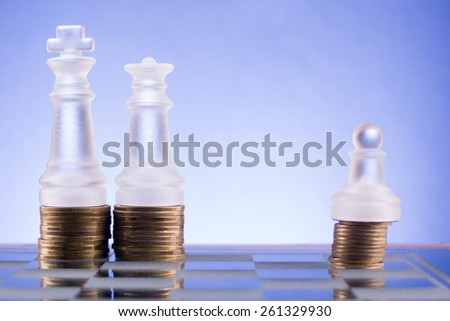 Chess on a golden coins. Investment strategy. Finance concept. - stock photo