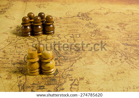 Chess on old map - stock photo