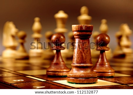 Chess on the dark background.