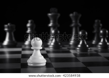 Chess pawn concept in black and white - stock photo