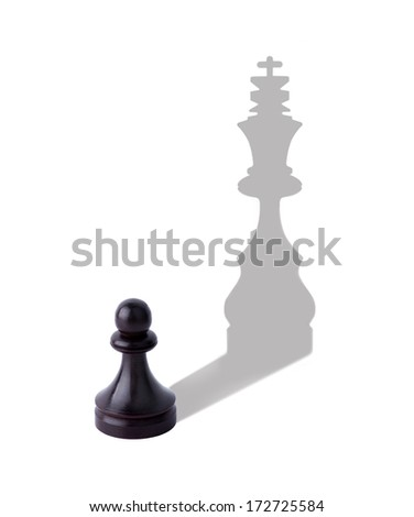 Chess - pawn with a shadow of the king - stock photo