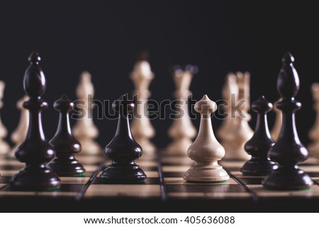 Chess pawns on the chessboard. Closeup - stock photo