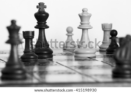 Chess photographed on a chessboard - stock photo