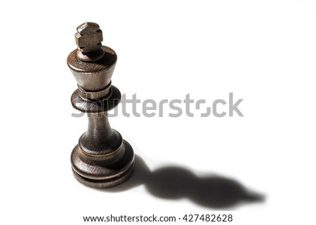Chess piece king with shadow isolated on white background