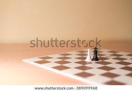 Chess pieces as metaphor - king and queen as heterosexual couple. Creamy tint and shallow focus