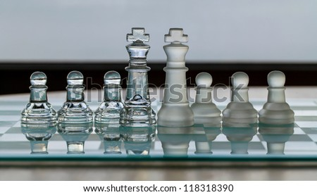 Chess Pieces - King and pawns as business concept - merge / merger. - stock photo