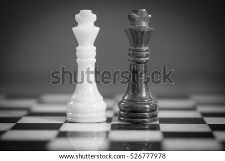 Chess pieces kings facing each other for a standoff. Chess kings confronting each other. Chess kings head to head. Black & White.