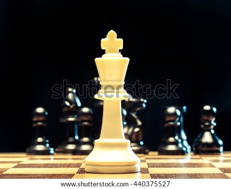 chess pieces on a black background