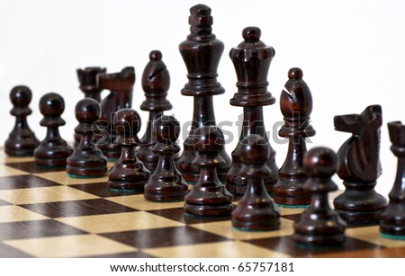 Chess pieces on a board with white background