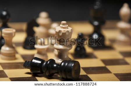 chess pieces on a chess board table - stock photo