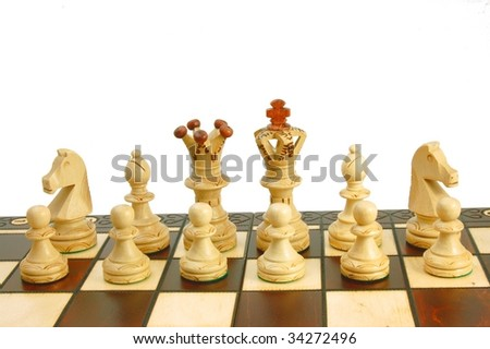 chess pieces on board - white backgound - symbol of strategy - stock photo