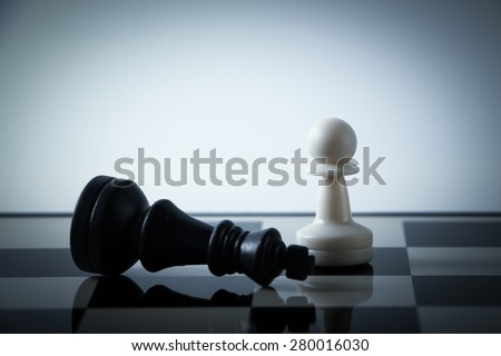 Chess pieces on board with gradually varied background. Strategy concept. - stock photo