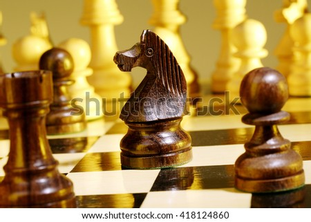 Chess pieces on chess board - stock photo