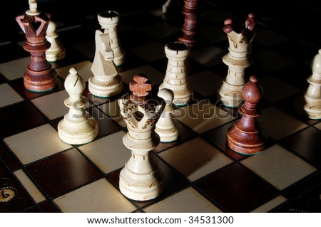 chess pieces on chess board showing power and success - stock photo