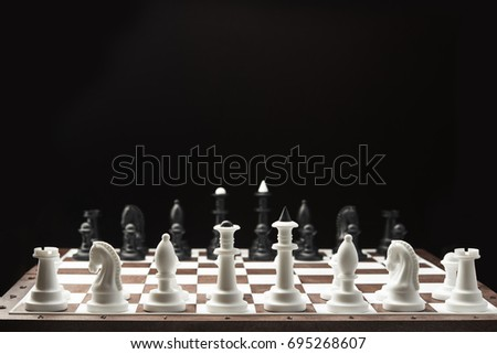 chess pieces on the board, black background