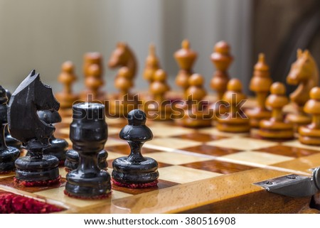 Chess pieces on the field - stock photo