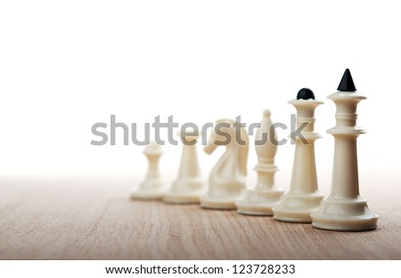 chess pieces on wooden table