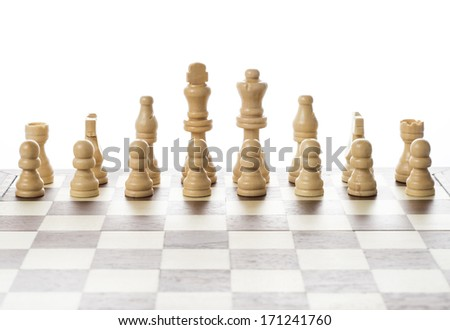 Chess pieces set on a chessboard - stock photo
