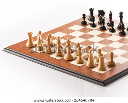 Chess pieces setup before the game - black and white chess pieces standing on a chessboard - stock photo