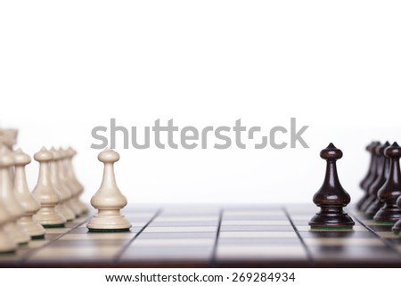 Chess pieces showing the competition, in business and game - stock photo