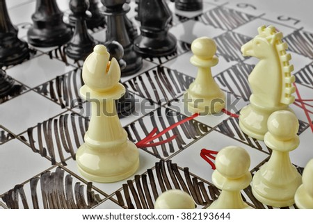 Chess. The white Bishop is under attack. White board with chess figures on it. Plan of battle. - stock photo