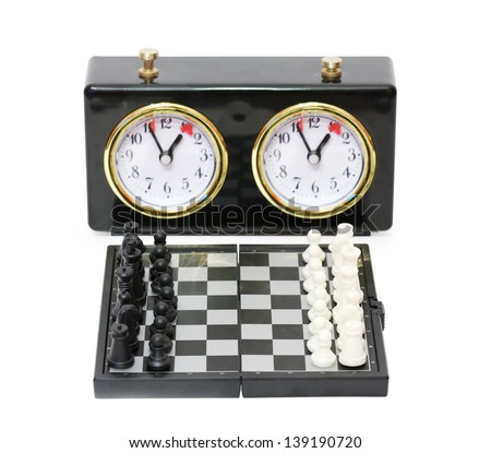 Chess timer and chess board with figures isolated on white background. - stock photo