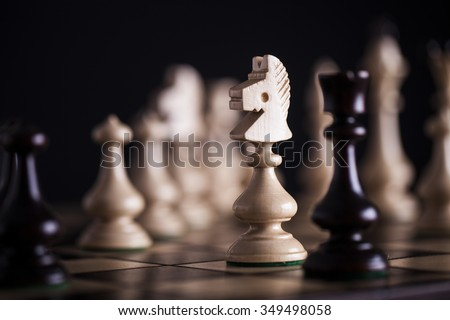 Chess. White pawns vs black on wooden chessboard - stock photo