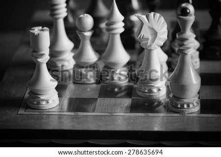 chessboard figure game confrontation - stock photo