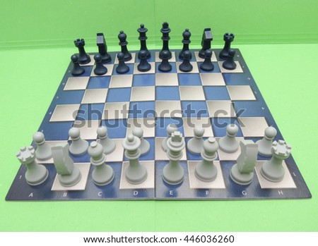 chessboard with black and white plastic checkers - stock photo