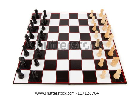 Chessboard with chess pieces against white background - stock photo