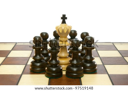 Chessmen and chess board on a white isolated background.