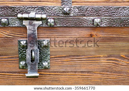 chest buckle. Macro detail of a wooden box metal latch. wooden box latch. close-up of the treasure chest - stock photo