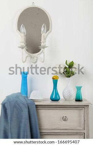 Chest of drawers with vases on top