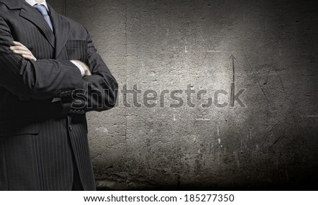 Chest view of businessman with arms crossed on chest - stock photo