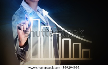 Chest view of businesswoman drawing infographs on digital screen